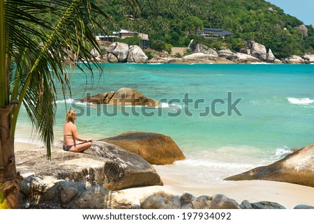 Meditation yoga girl at Coral Cove beach at Koh Samui Island Thailand