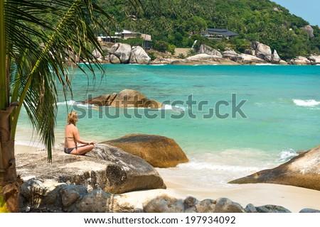 Meditation yoga girl at Coral Cove beach at Koh Samui Island Thailand  - stock photo