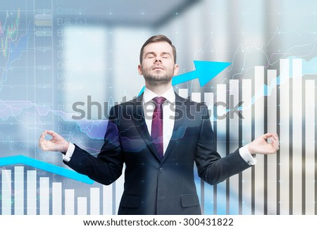 Meditative businessman is looking for the perfect business solution. Financial charts and office view in blur on the background.