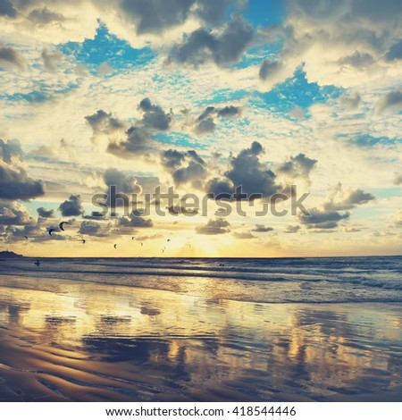 Mediterranean beach gold sunset view and kite surfing. Toned colors vintage photo - stock photo