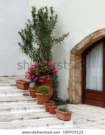 Mediterranean Courtyard with Flower Pots - stock photo