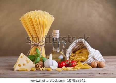Mediterranean cuisine and diet ingredients - pasta and fresh seasoning - stock photo