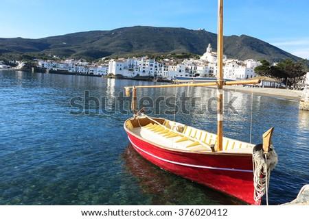 Mediterranean fishing boat. Cadaques in Costa Brava of Catalonia, Spain. - stock photo