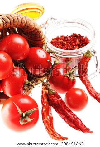 Mediterranean Food: cherry tomatoes and dried hot chili peppers - stock photo