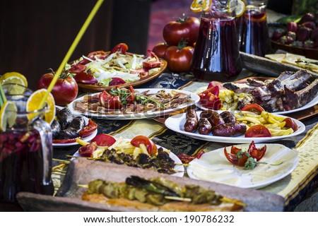 Mediterranean food plates, European cuisine, medieval fair in Spain - stock photo