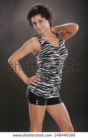 Mediterranean gal in zebra top - stock photo