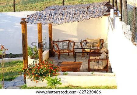 Mediterranean Garden Patio, Lounge Chairs Under Bamboo Roof, Chalkidiki,  Greece