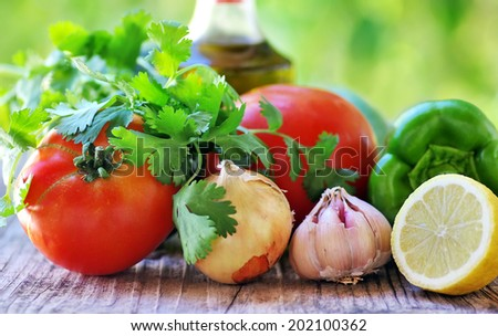 mediterranean herbs , tomatoes and  olive oil - stock photo