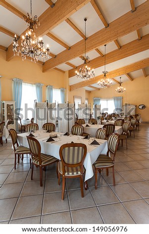 Mediterranean interior - an elegant dining room with chandeliers