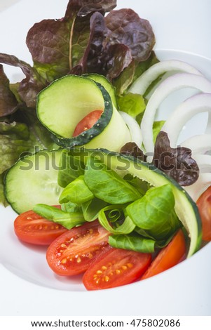 Mediterranean or garden salad as a healthy food starter on a restaurant table