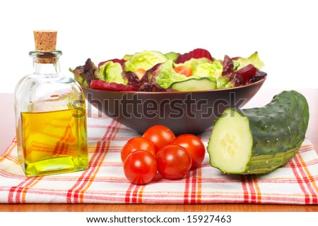 Mediterranean salad with lettuce tomatoes cucumber oil and beet. Shallow depth of field