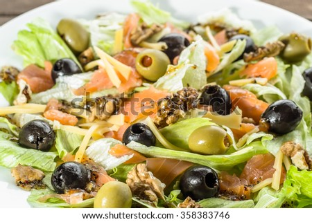 Mediterranean salad with salmon and olives, selective focus - stock photo