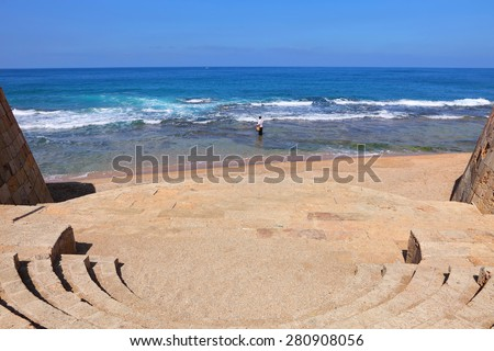 Mediterranean seaside of Ancient Acre (Akko) with fisherman fishing. Mediterranean, Israel. Old town of Acre is UNESCO World Heritage. Beautiful seaside and fisherman fishing - stock photo