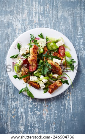 Mediterranean-style chicken salad with feta cheese - stock photo