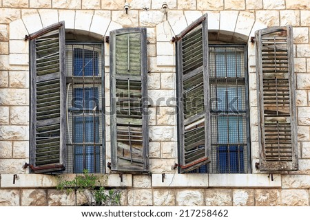 Mediterranean windows with shutters  - stock photo