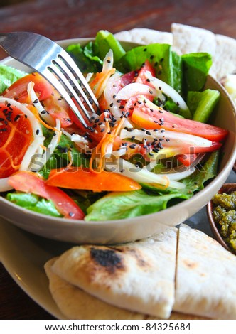 mediterrenean salad with cheese and bread - stock photo