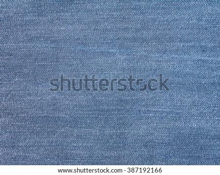Medium blue washed jeans denim textile background - stock photo