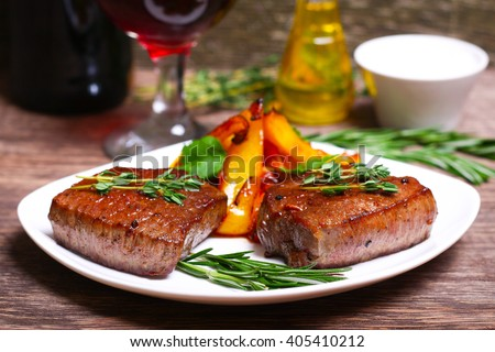 medium roast rib-eye steak with pepper, thyme and salt - stock photo