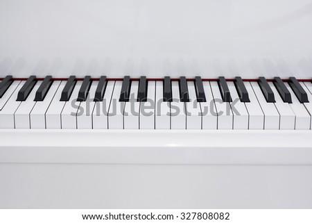 Medium shot of white piano. - stock photo