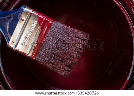 Medium size paintbrush with maroon color  - stock photo