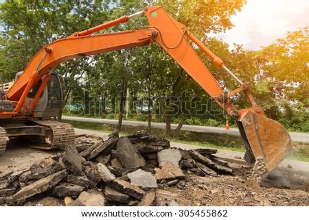 Medium sized excavator - stock photo
