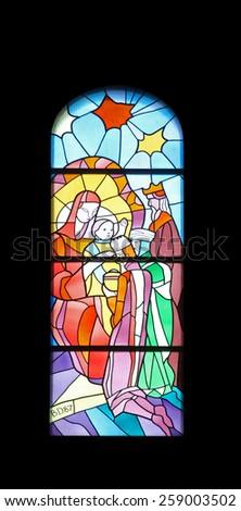 MEDUGORJE, BOSNIA AND HERZEGOVINA - FEBRUARY 19: Nativity Scene, Adoration of the Magi, stained glass church window in the parish church of St. James in Medugorje on February 19, 2011. - stock photo
