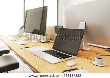 meeting conference table with accessories and computers - stock photo