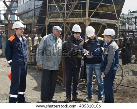 Meeting management engineers to repair ships - stock photo