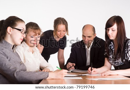 meeting of a staff at the table - stock photo