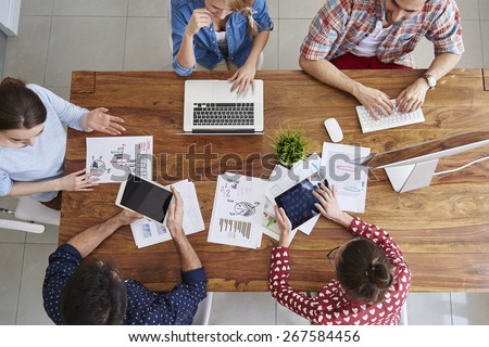 Meeting of co-workers and planning next steps of work  - stock photo