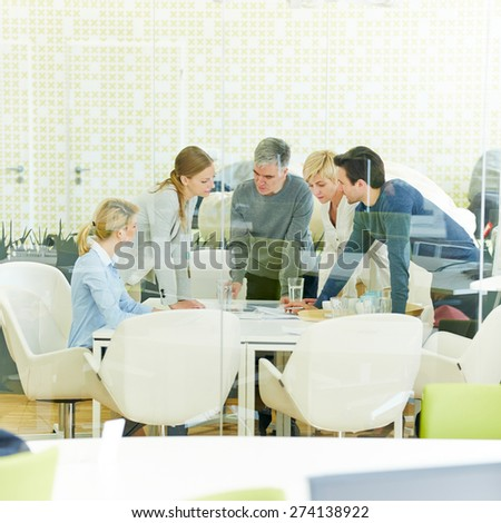 Meeting of consulting team in conference room of office - stock photo