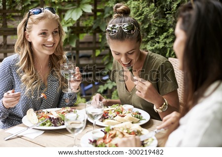 Meeting of girls at the fashion restaurant  - stock photo