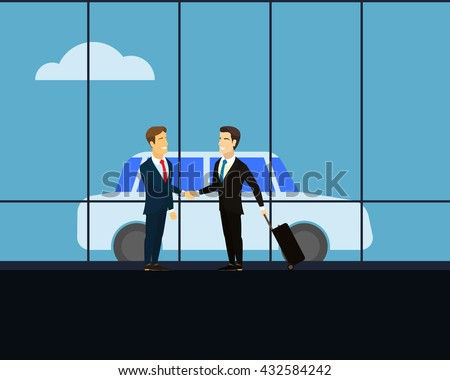 Meeting of two businessmen on the background of glass windows. Men shaking hands at a meeting. Man with luggage on wheels on a business trip. Blue car in the background. White cloud on the blue sky.