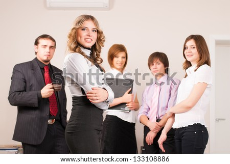 Meeting of young business people in office