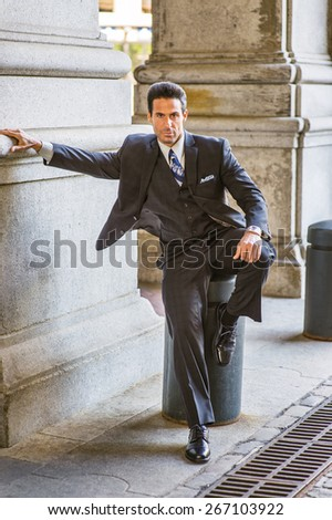 Meeting on street. Dressing in dark blue three pieces suit, necktie, vest,  leather shoes, bending a leg, stretch a arm,  a handsome, middle age businessman sitting on street,  waiting for you  - stock photo