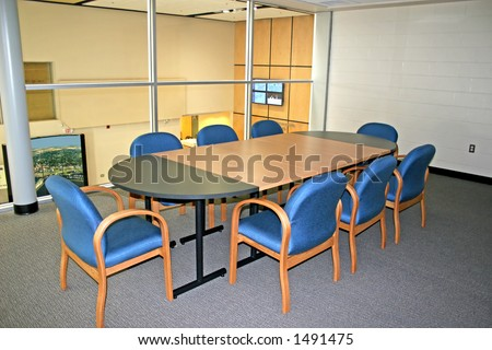 Meeting room in a modern building with a glass wall.
