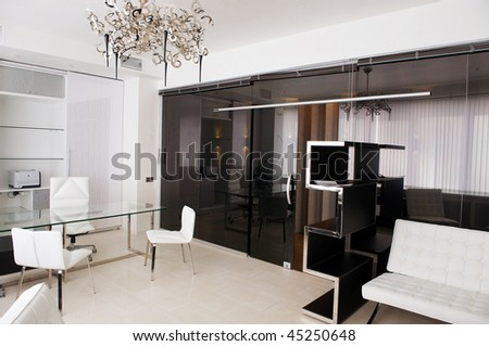 meeting room of glass with leather furniture - stock photo