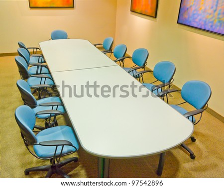 Meeting room. The table and the chairs. - stock photo