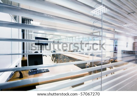 meeting room view across jalousie - stock photo