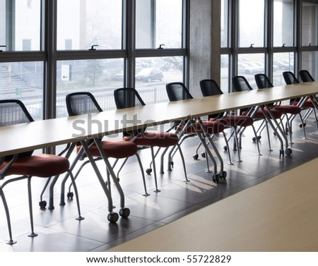 meeting room with a long table next the window