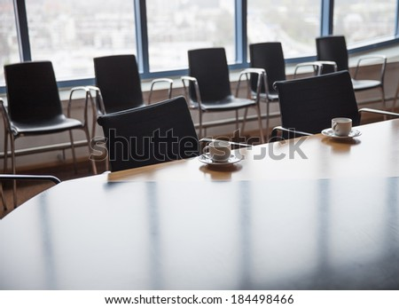 Meeting room with coffee cups before meeting - stock photo