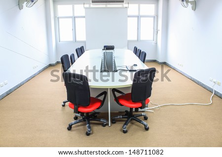 meeting room with projection screen - stock photo