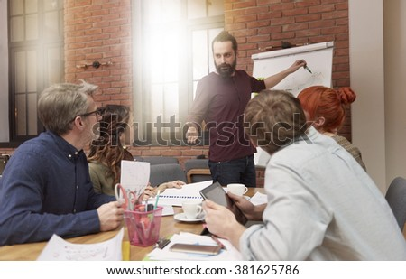 Meeting with coworkers in the boardroom  - stock photo