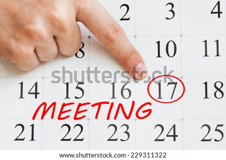 Meeting written in a calendar page - stock photo