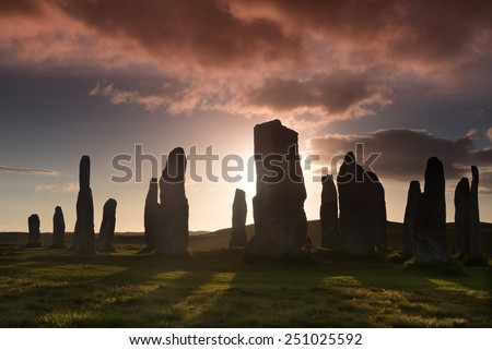 Megalithic stone circle of 3000 bc on the Isle of Lewis and Harris, Outer Hebrides, Scotland at sunset - stock photo