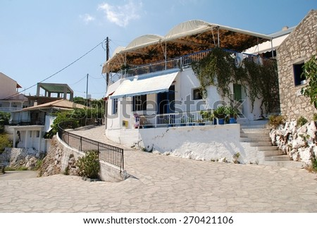MEGANISSI, GREECE - AUGUST 31, 2008: A narrow street in Spartohori on the Greek island of Meganissi. The Ionian island is a satellite of nearby Lefkada and has a population of around 1100 people. - stock photo