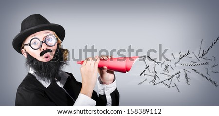 Megaphone man making loud business noise with hand held speaker on grey background. Advertise