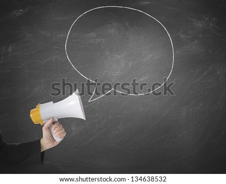 Megaphone with message in a blackboard - stock photo