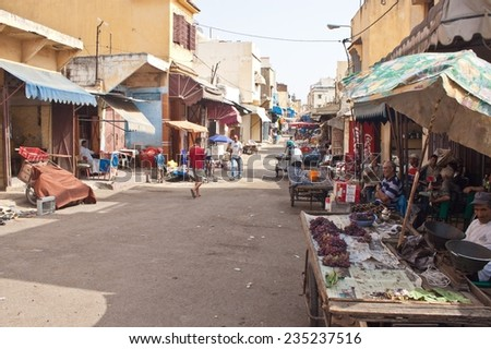 MEKNES, MOROCCO - JULY 28: People on a street market on July 28, 2010 in Meknes, Morocco. Meknes is a 1000 years old imperial city in Morocco. - stock photo
