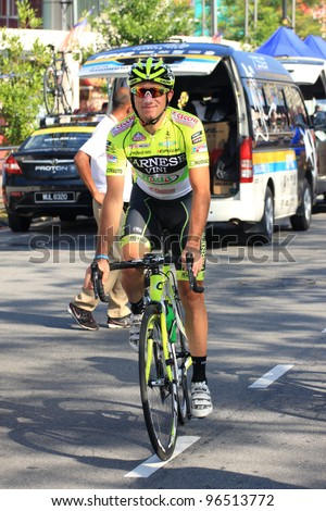 MELAKA, MALAYSIA-FEB 28: An unidentified cyclists from team Farnese Vini-Selle Italia warms up before starts race during stage 5 of the Tour de Langkawi on February 28, 2012 in Melaka,Malaysia. - stock photo